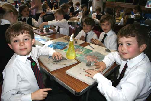 pupils making clay models