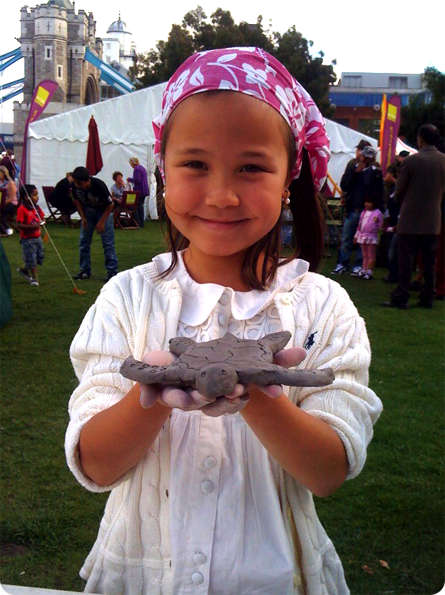 girl with her clay model